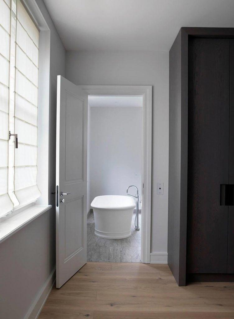 master bathroom with free-standing Devon&Devon tub and fittings from Dornbracht