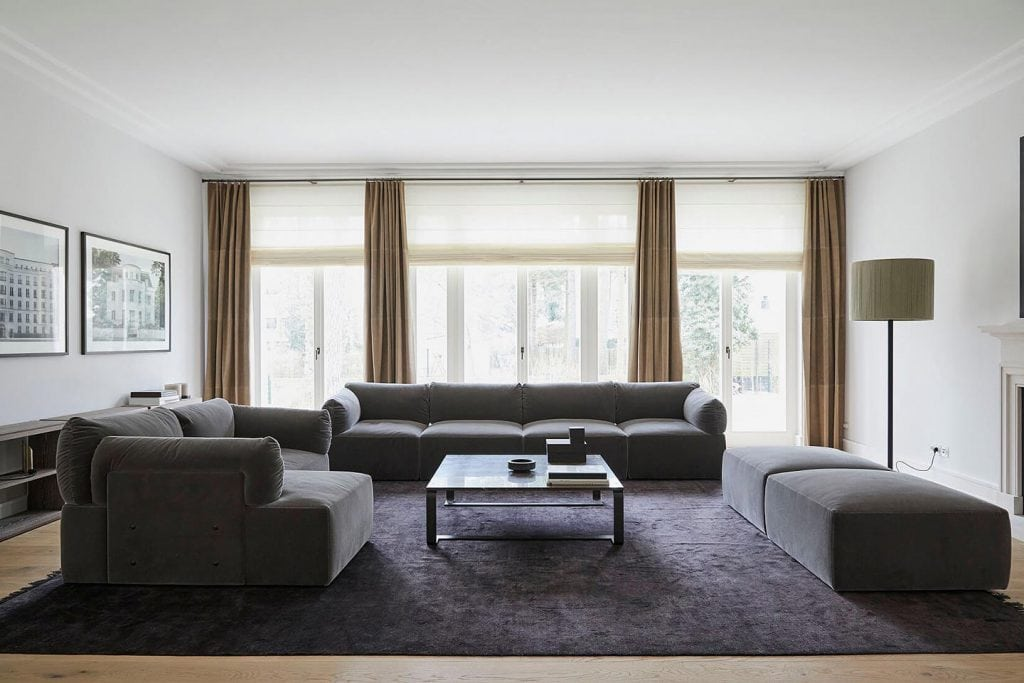 "Bottega Veneta's mohair-covered ""Tassello"" sofas and pouffes arranged around a marble-topped ""Floating Square"" coffee table"